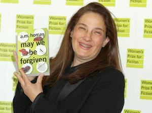 American novelist A.M. Homes holds a copy of her book 'May We Be Forgiven'
